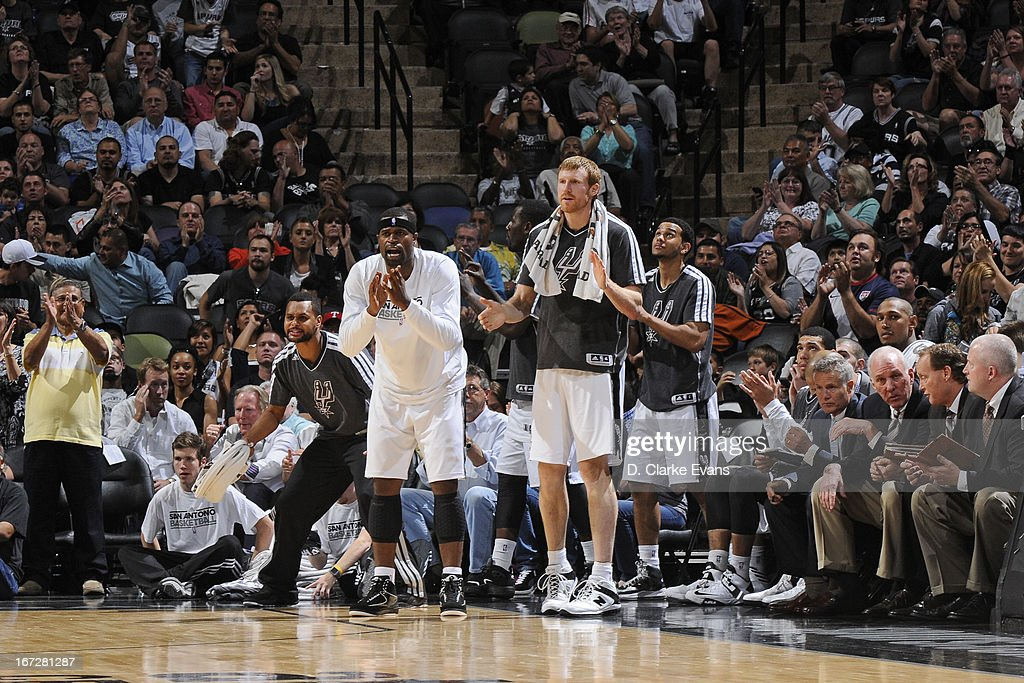 Patty Mills #8 and <a gi-track='captionPersonalityLinkClicked' href=/galleries/search?phrase=Matt+Bonner&family=editorial&specificpeople=203054 ng-click='$event.stopPropagation()'>Matt Bonner</a> #15 of the San Antonio Spurs celebrate a play during the game against the Utah Jazz on March 22, 2013 at the AT&T Center in San Antonio, Texas.
