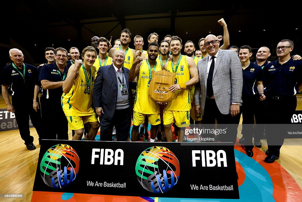 Patty Mills and Matthew Dellavedova of the Boomers hold the Al Ramsay Shield after winning the game two match between the New Zealand Tall Blacks and Australian Boomers at at TSB Bank Arena on August 18, 2015 in Wellington, New Zealand.