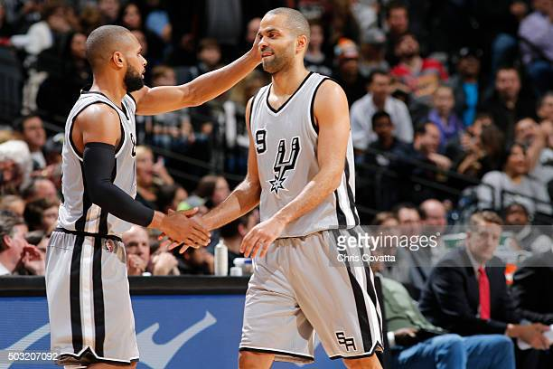 Patty Mills and Tony Parker of the San Antonio Spurs during the game against the Houston Rockets on January 2 2016 at ATT Center in San Antonio Texas...
