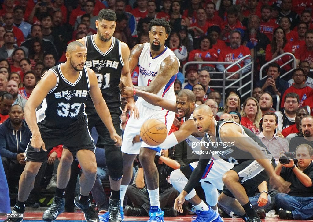 Patty Mills Boris Diaw and Tim Duncan of the San Antonio Spurs in action against Los Angeles Clippers during the first round of the 2015 NBA Western...