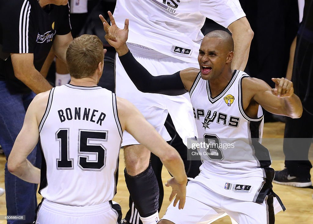Patty Mills #8 celebrates with Matt Bonner #15 of the San Antonio Spurs after defeating the Miami Heat in Game Five of the 2014 NBA Finals at the AT&T Center on June 15, 2014 in San Antonio, Texas.