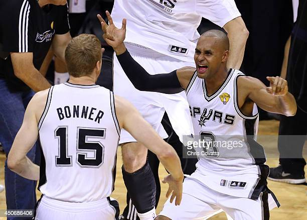 Patty Mills celebrates with Matt Bonner of the San Antonio Spurs after defeating the Miami Heat in Game Five of the 2014 NBA Finals at the ATT Center...