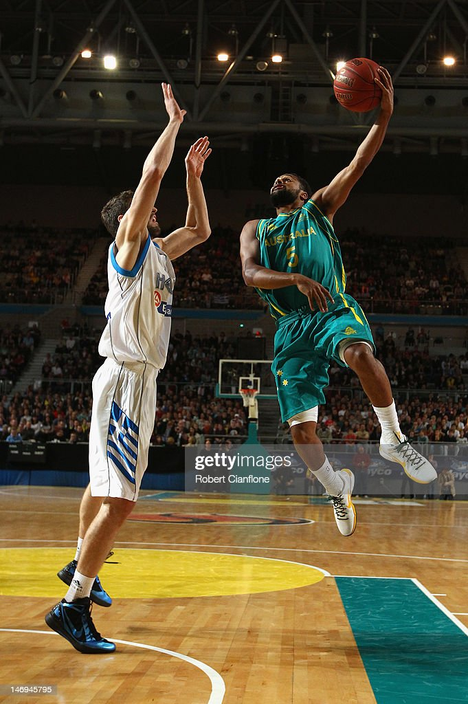 Patty Mills of Australia gets up to score during the first match between the Australian Boomers and Greece at Hisense Arena on June 24, 2012 in Melbourne, Australia.