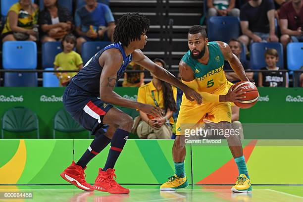 Patty Mills of Australia handles the ball against Mickael Gelabale of France on Day 1 of the Rio 2016 Olympic Games at Carioca Arena 1 on August 6...