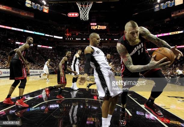 Patty Mills of the San Antonio Spurs and Chris Andersen of the Miami Heat battle for a loose ball during Game Two of the 2014 NBA Finals at the ATT...