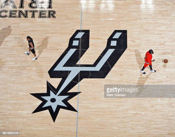 Patty Mills of the San Antonio Spurs and James Harden of the Houston Rockets warm up before the game in Game Five of the Western Conference...