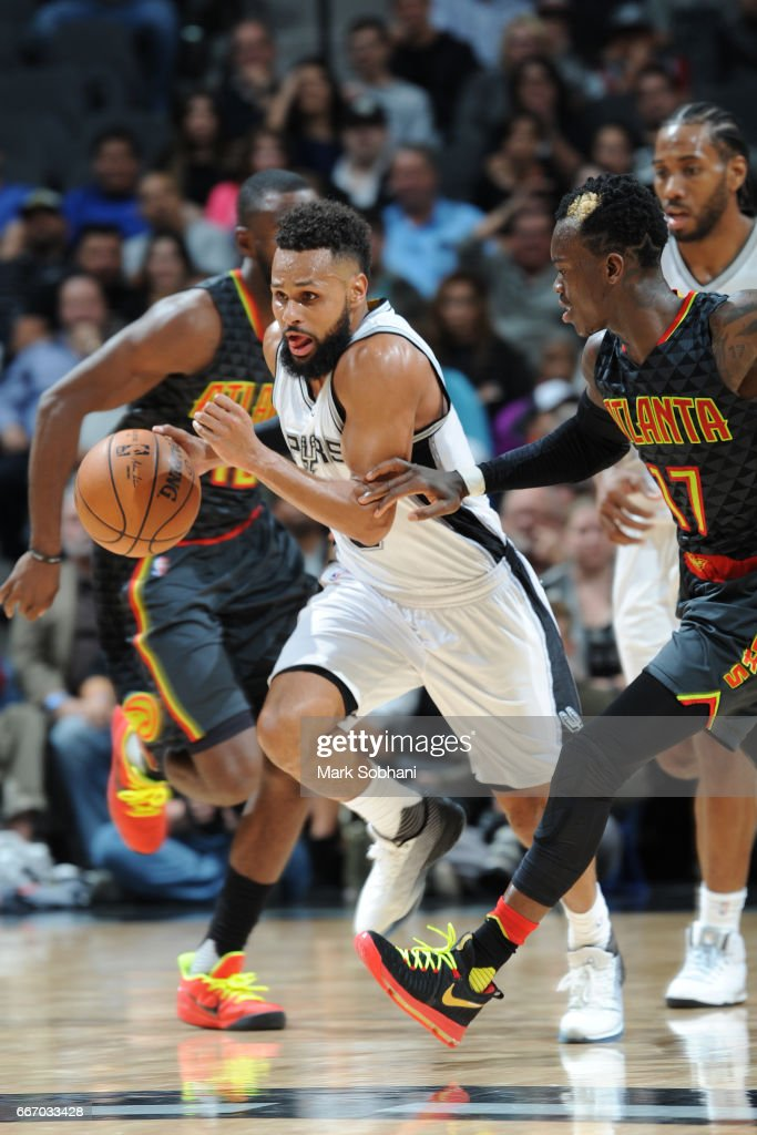 Patty Mills #8 of the San Antonio Spurs brings the ball up court during the game against the Atlanta Hawks on March 13, 2017 at the AT&T Center in San Antonio, Texas.