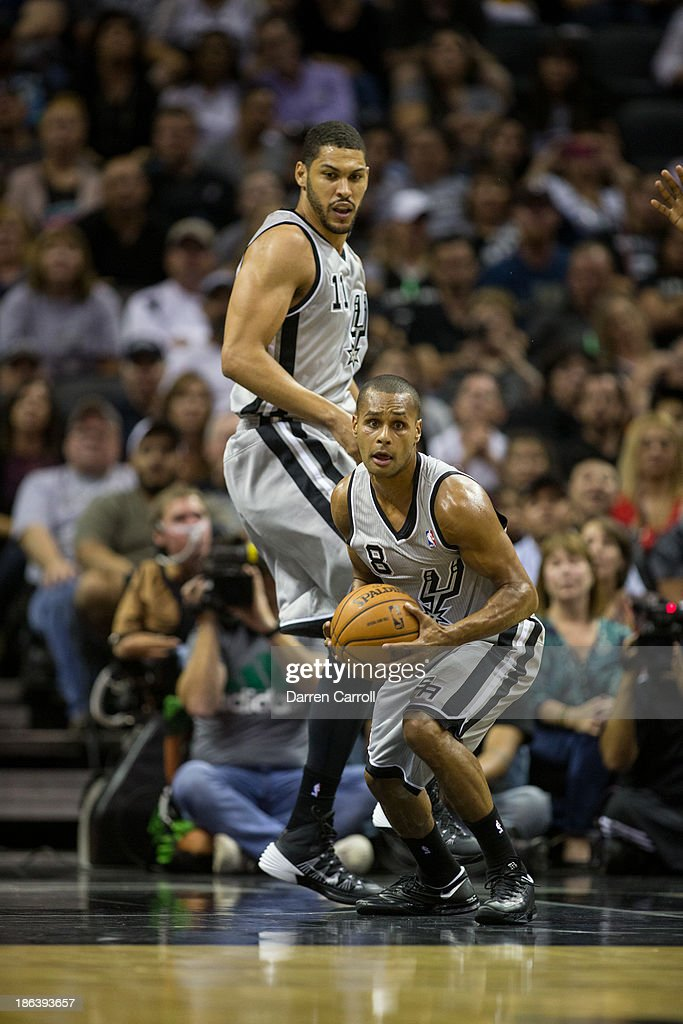 Patty Mills #8 of the San Antonio Spurs collects a rebound in a game against the Memphis Grizzlies on October 30, 2013 at the AT&T Center in San Antonio, Texas.