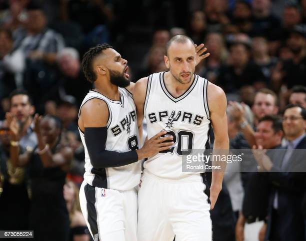 Patty Mills of the San Antonio Spurs congratulates Manu Ginobili of the San Antonio Spurs after a defensive effort against the Memphis Grizzlies in...