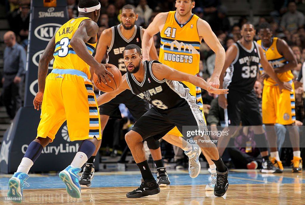 Patty Mills #8 of the San Antonio Spurs defends against <a gi-track='captionPersonalityLinkClicked' href=/galleries/search?phrase=Ty+Lawson&family=editorial&specificpeople=4024882 ng-click='$event.stopPropagation()'>Ty Lawson</a> #3 of the Denver Nuggets at the Pepsi Center on December 18, 2012 in Denver, Colorado. The Nuggets defeated the Spurs 112-106.