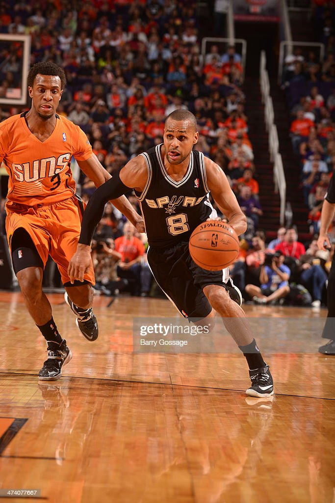 Patty Mills #8 of the San Antonio Spurs drives against Ish Smith #3 of the Phoenix Suns on February 21, 2014 at U.S. Airways Center in Phoenix, Arizona.