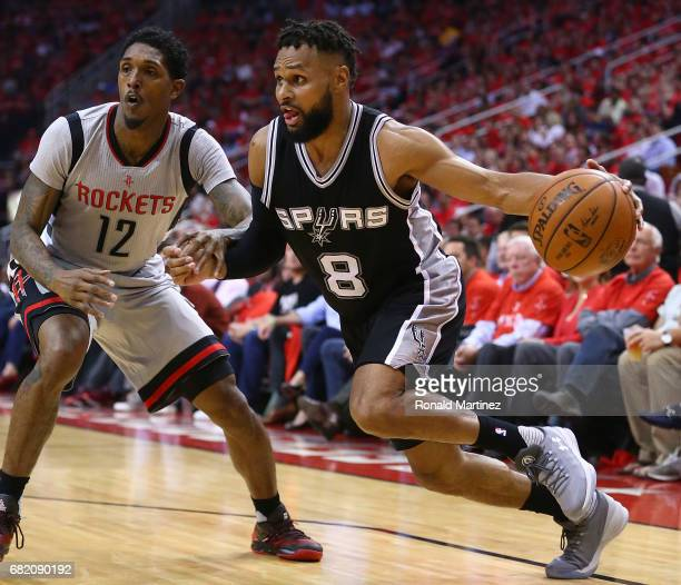 Patty Mills of the San Antonio Spurs drives against Lou Williams of the Houston Rockets during Game Six of the NBA Western Conference SemiFinals at...