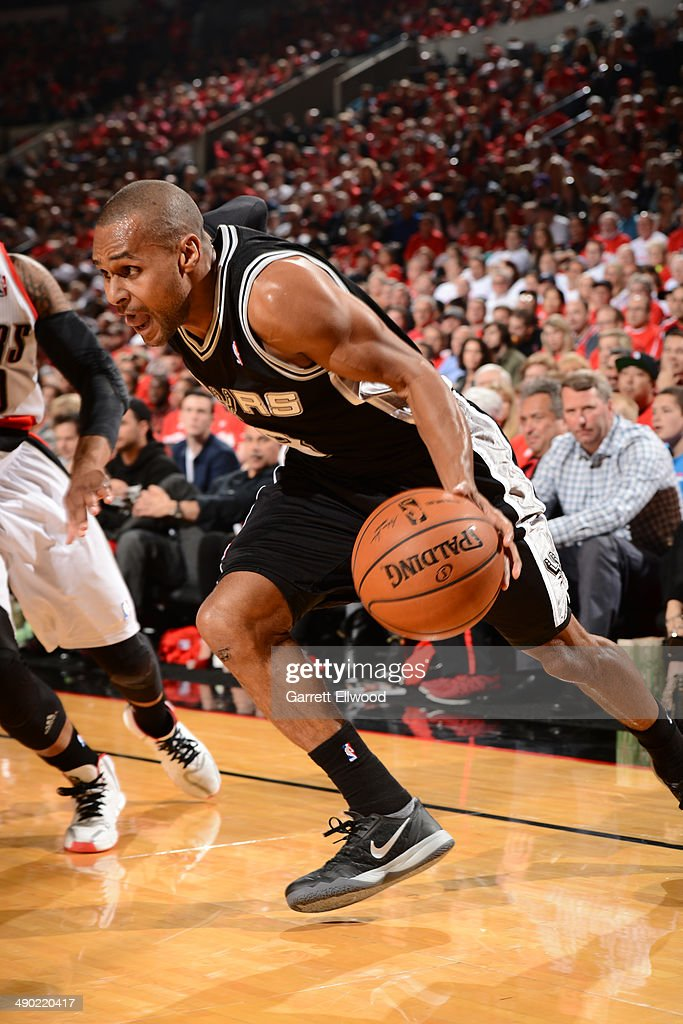 Patty Mills #8 of the San Antonio Spurs drives to the basket against the Portland Trail Blazers in Game Three of the Western Conference Semifinals on May 10, 2014 at the Moda Center in Portland, Oregon.