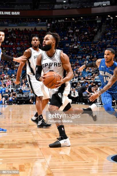 Patty Mills of the San Antonio Spurs drives to the basket against the Orlando Magic on October 27 2017 at Amway Center in Orlando Florida NOTE TO...