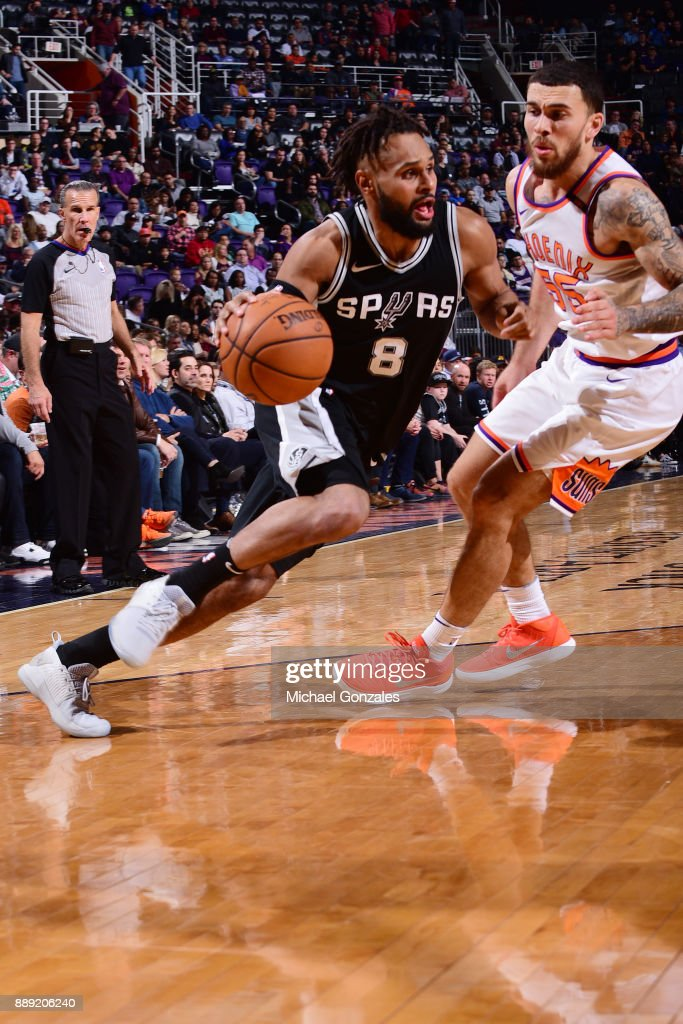 Patty Mills #8 of the San Antonio Spurs drives to the basket against the Phoenix Suns on December 9, 2017 at Talking Stick Resort Arena in Phoenix, Arizona.