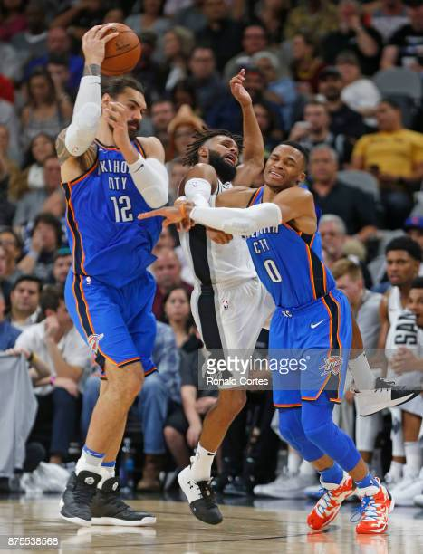 Patty Mills of the San Antonio Spurs fouls Russell Westbrook of the Oklahoma City Thunder who was trying to get the handoff from Steven Adams of the...