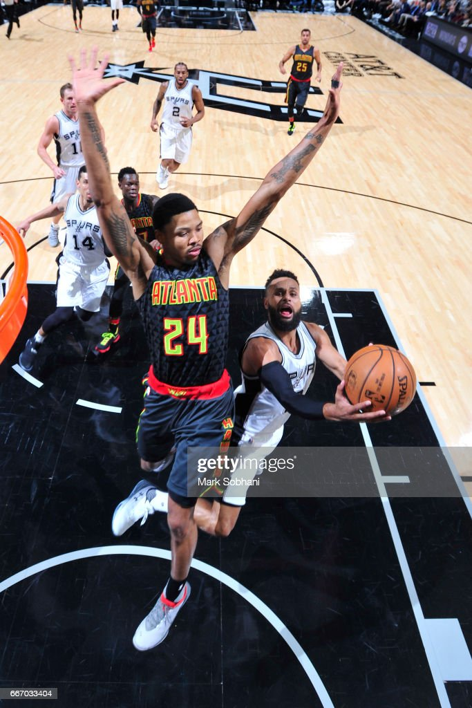 Patty Mills #8 of the San Antonio Spurs goes for a lay up during the game against the Atlanta Hawks on March 13, 2017 at the AT&T Center in San Antonio, Texas.