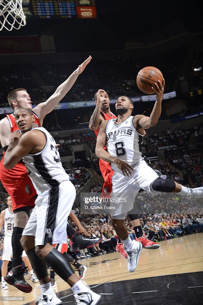 Patty Mills #8 of the San Antonio Spurs goes up for the layup against the Portland Trail Blazers on MARCH 8, 2013 at the AT&T Center in San Antonio, Texas.