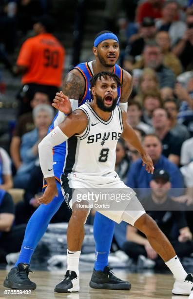 Patty Mills of the San Antonio Spurs guards Carmelo Anthony of the Oklahoma City Thunder at ATT Center on November 17 2017 in San Antonio Texas NOTE...