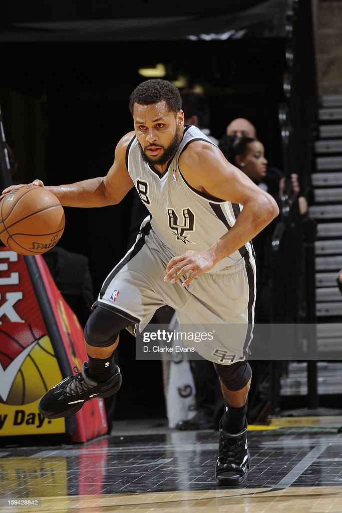 Patty Mills #8 of the San Antonio Spurs handles the ball against the Minnesota Timberwolves on January 13, 2013 at the AT&T Center in San Antonio, Texas.