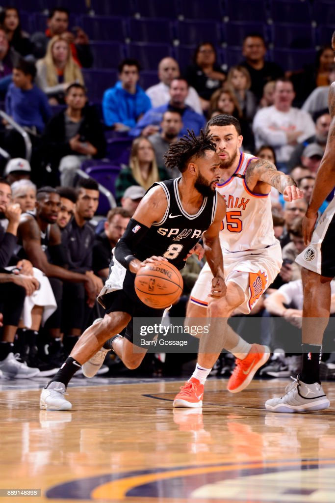 Patty Mills #8 of the San Antonio Spurs handles the ball against the Phoenix Suns on December 9, 2017 at Talking Stick Resort Arena in Phoenix, Arizona.