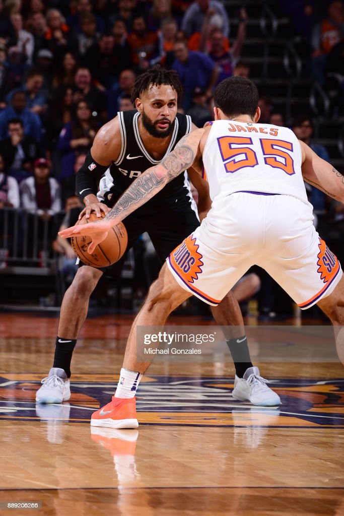 Patty Mills #8 of the San Antonio Spurs jocks for a position against the Phoenix Suns on December 9, 2017 at Talking Stick Resort Arena in Phoenix, Arizona.