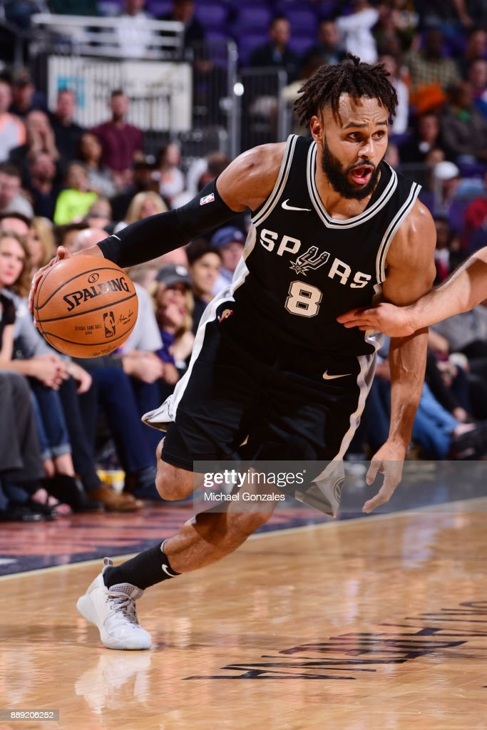 Patty Mills #8 of the San Antonio Spurs looks to pass the ball against the Phoenix Suns on December 9, 2017 at Talking Stick Resort Arena in Phoenix, Arizona.