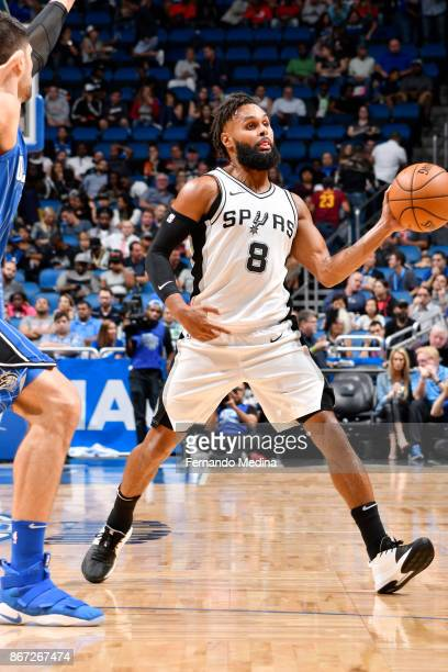 Patty Mills of the San Antonio Spurs passes the ball against the Orlando Magic on October 27 2017 at Amway Center in Orlando Florida NOTE TO USER...