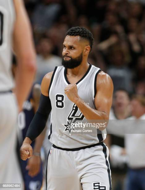 Patty Mills of the San Antonio Spurs reacts after making a shot against the Memphis Grizzlies in Game One of the Western Conference Quarterfinals...
