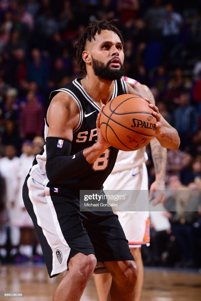 Patty Mills #8 of the San Antonio Spurs shoots a free throw against the Phoenix Suns on December 9, 2017 at Talking Stick Resort Arena in Phoenix, Arizona.