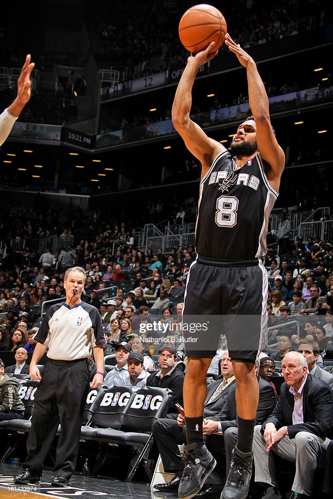 Patty Mills #8 of the San Antonio Spurs shoots a three-pointer against the Brooklyn Nets on February 10, 2013 at the Barclays Center in the Brooklyn borough of New York City.