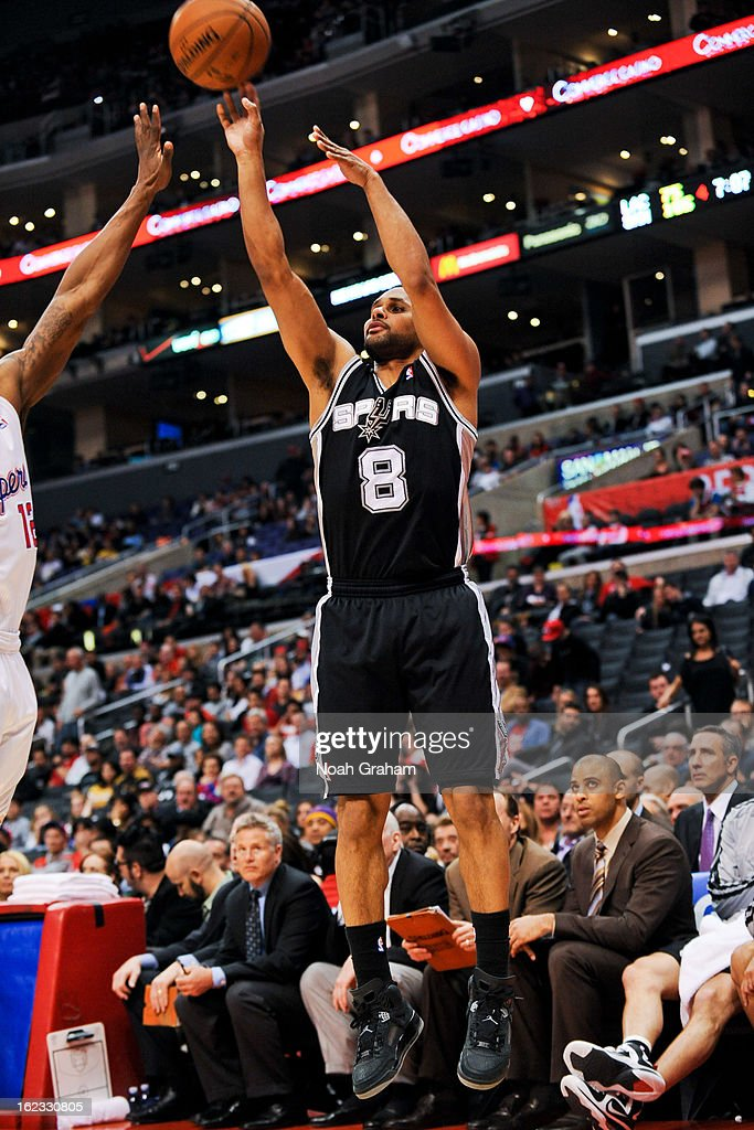 Patty Mills #8 of the San Antonio Spurs shoots a three-pointer against the Los Angeles Clippers at Staples Center on February 21, 2013 in Los Angeles, California.