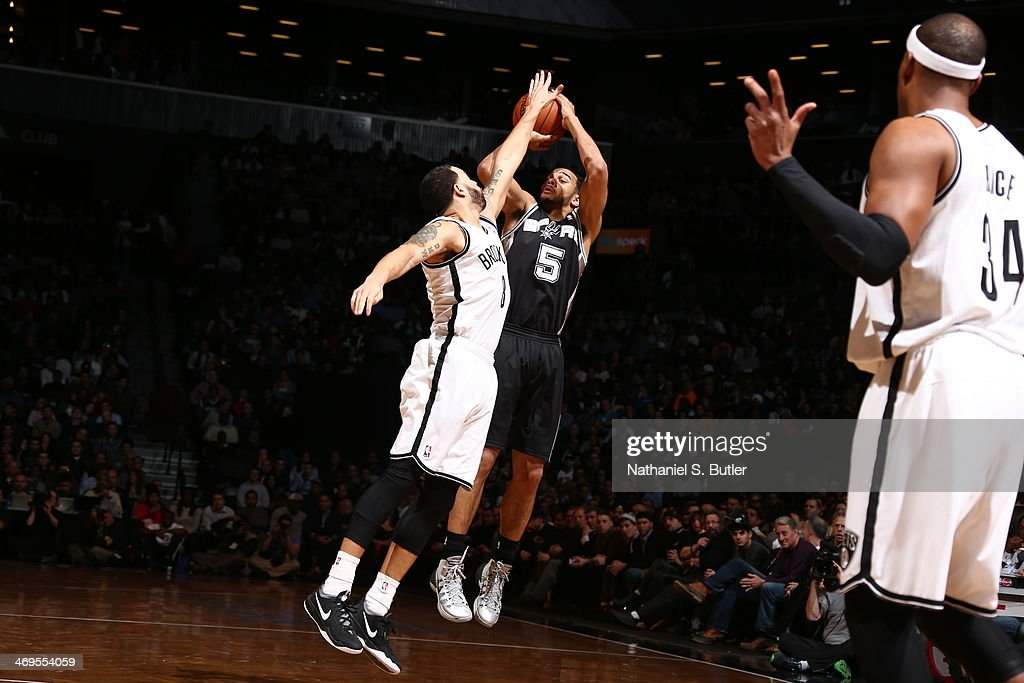 Patty Mills #8 of the San Antonio Spurs shoots against the Brooklyn Nets at the Barclays Center on February 06, 2014 in the Brooklyn borough of New York City.