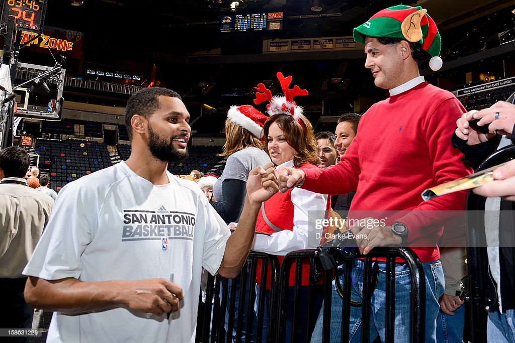 Patty Mills #8 of the San Antonio Spurs signs autographs for fans before a game against the New Orleans Hornets on December 21, 2012 at the AT&T Center in San Antonio, Texas.