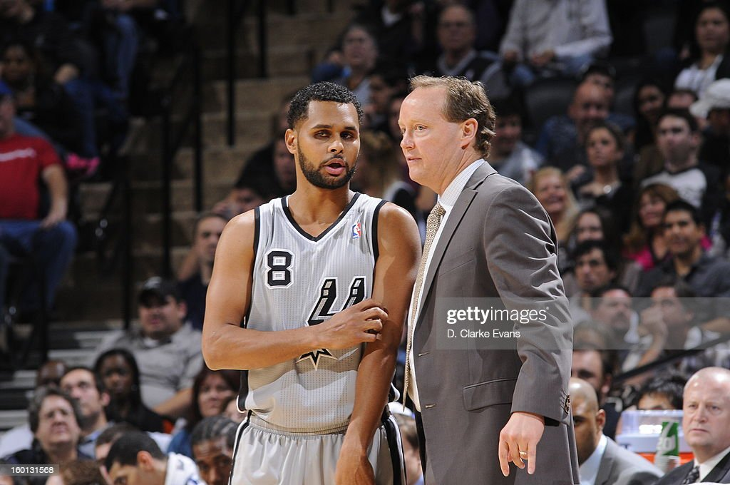 Patty Mills #8 of the San Antonio Spurs talks with acting head coach, Mike Budenholzer, during a break in play against the Phoenix Suns on January 26, 2013 at the AT&T Center in San Antonio, Texas.