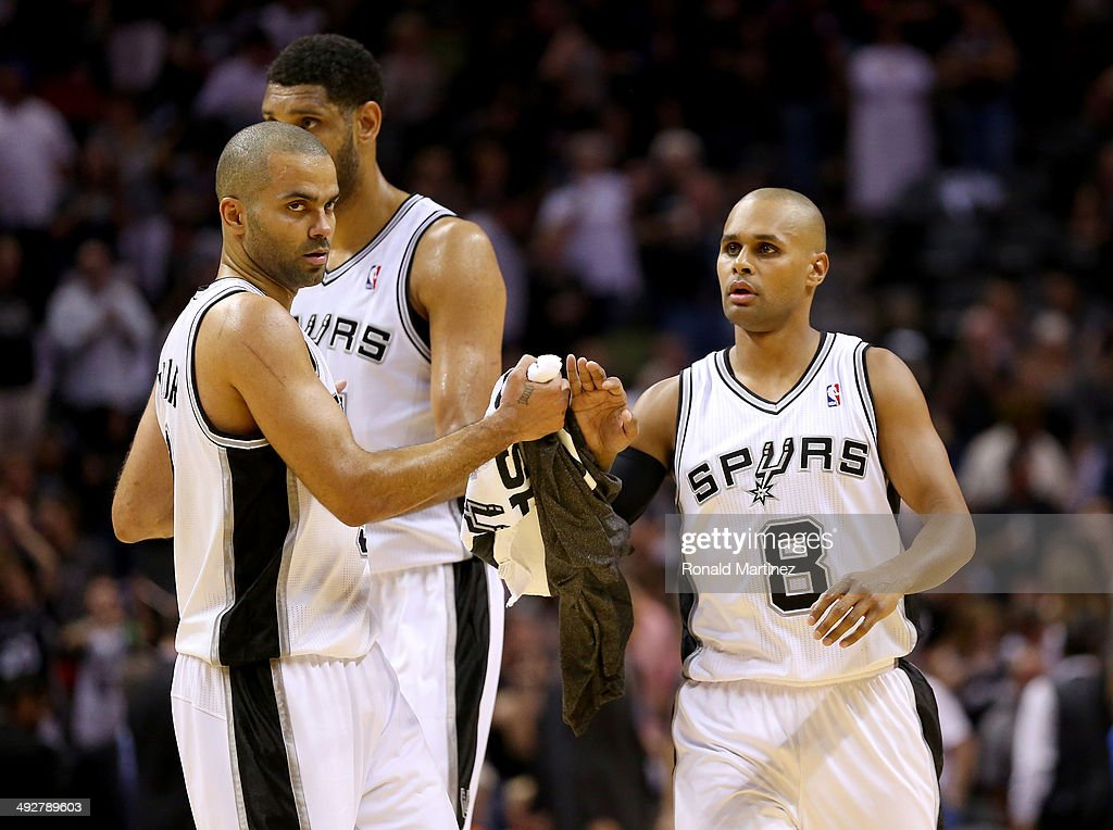 Patty Mills #8, Tony Parker #9 and <a gi-track='captionPersonalityLinkClicked' href=/galleries/search?phrase=Tim+Duncan&family=editorial&specificpeople=201467 ng-click='$event.stopPropagation()'>Tim Duncan</a> #21 of the San Antonio Spurs celebrate in the second quarter while taking on the Oklahoma City Thunder in Game Two of the Western Conference Finals during the 2014 NBA Playoffs at AT&T Center on May 21, 2014 in San Antonio, Texas.