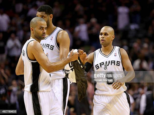 Patty Mills Tony Parker and Tim Duncan of the San Antonio Spurs celebrate in the second quarter while taking on the Oklahoma City Thunder in Game Two...