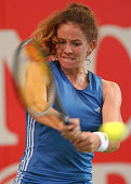 Patty Schnyder of Switzerland hits a backhand in her semi final against MarieGaianeh Mikaelian of Switzerland during the Uncle Tobys Hardcourts at...