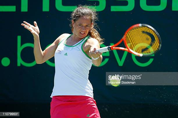 Patty Schnyder of Switzerland hits a return against Lucie Safarova of the Czech Republic during the Sony Ericsson Open at Crandon Park Tennis Center...
