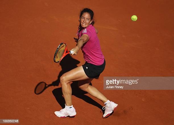 Patty Schnyder of Switzerland plays a backhand during the women's singles first round match between Venus Williams of the United States and Patty...