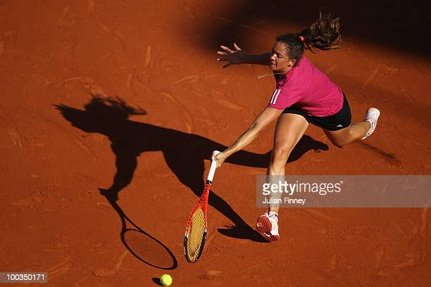 Patty Schnyder of Switzerland stretches to hit a forehand during the women's singles first round match between Venus Williams of the United States...