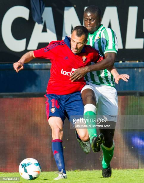 Patxi Punal Martinez of CA Osasuna duels for the ball with Alfred Ndiaye of Real Betis Balompie during the La Liga match between CA Osasuna and Real...