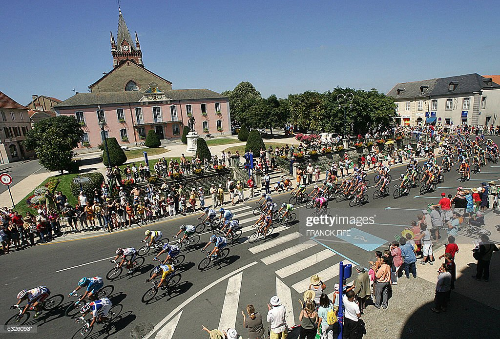 The pack rides through a village during the 17th stage of the 92nd Tour de France cycling race between Pau and Revel 20 July 2005 AFP PHOTO FRANCK...