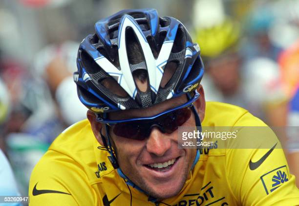 Yellow jersey US Lance Armstrong smiles during the 17th stage of the 92nd Tour de France cycling race between Pau and Revel 20 July 2005 AFP PHOTO...