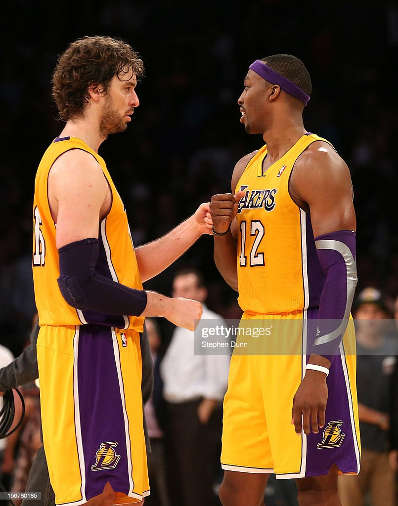 Pau Gasol #16 and Dwight Howard #12 of the Los Angeles Lakers celebrate after the Lakers survive the last shot attempt by the Brooklyn Nets at Staples Center on November 20, 2012 in Los Angeles, California. The Lakers won 95-90.