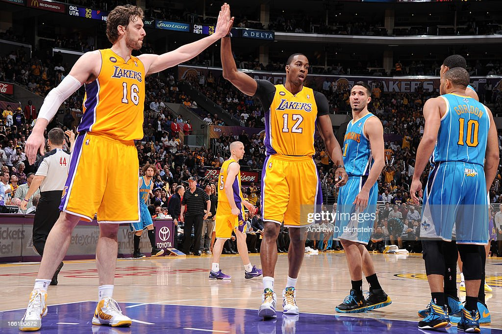 Pau Gasol #16 and Dwight Howard #12 of the Los Angeles Lakers celebrate during their game against the New Orleans Hornets at Staples Center on April 9, 2013 in Los Angeles, California.