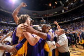 Pau Gasol and Kobe Bryant of the Los Angeles Lakers celebrate with their teammates after they won 9986 to win the NBA Championship against the...