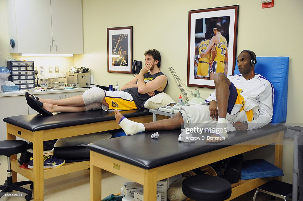 Pau Gasol #16 and Kobe Bryant #24 of the Los Angeles Lakers in the training room before the game against the Utah Jazz at Staples Center on December 9, 2012 in Los Angeles, California.
