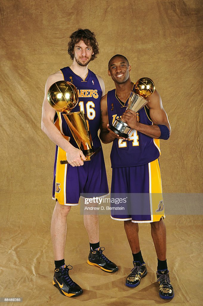 Pau Gasol #16 and Kobe Bryant #24 of the Los Angeles Lakers pose for a portrait after defeating the Orlando Magic in Game Five of the 2009 NBA Finals at Amway Arena on June 14, 2009 in Orlando, Florida. The Los Angeles Lakers defeated the Orlando Magic 99-86.