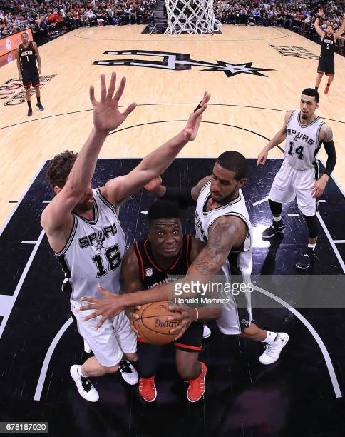 Pau Gasol and LaMarcus Aldridge of the San Antonio Spurs defend against Clint Capela of the Houston Rockets during Game Two of the NBA Western...